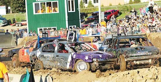 A collision takes place at the center of the arena during the Youth heat of last Saturday's Buffalo Demolition Derby at Corcoran Lions Park. Over 2,000 tickets were sold for this year's event, which moved from the Buffalo Rodeo Grounds to Corcoran....