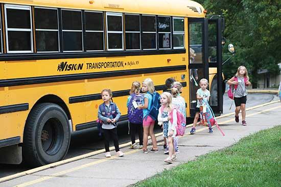 Students made their way from the bus to school Tuesday morning during the first day of school at Hanover Elementary. All elementary students, along with incoming sixth graders at Buffalo Community Middle School and freshmen at Buffalo High School,...