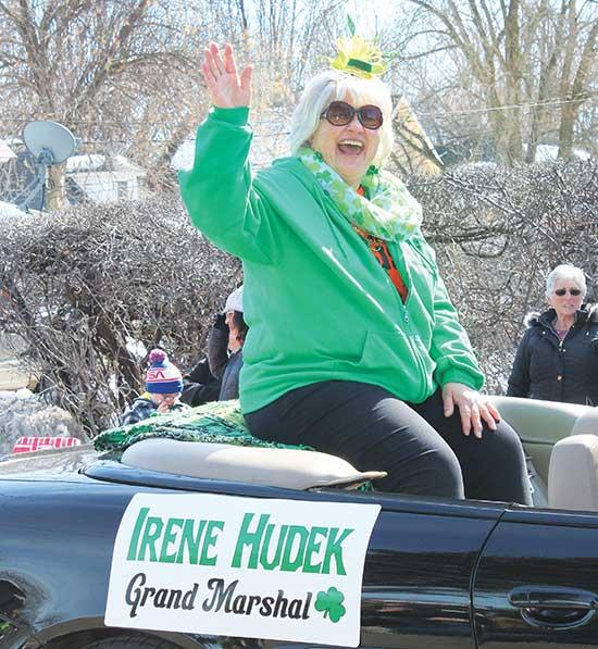 Irene Hudek (left), this year's Maple Lake Grande Day Parade Grand Marshal, waves enthusiastically to crowds gathered for festivities on Saturday. Close behind was Commodore Lynn Kissock. Ambassadors Susie Rieber (low left) and Lilly Workman (high...